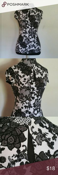 Lace print mock turtleneck blouse Black and white lace floral print blouse with mock turtle neck and keyhole in front. The sleeveless are slightly ruched. Express Tops Blouses