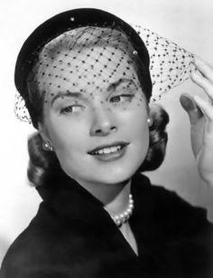 Grace Kelly in her birdcage veil hat