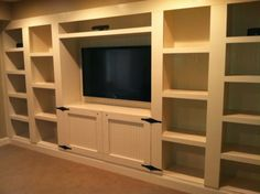 TV with built in shelving.