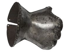 Gauntlet for the right hand. Italian, late 14th century. Made from a single steel plate, in 'hour-glass' form