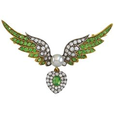 e7c55d75a An antique gold, silver, Oriental pearl, tsavorite and diamond brooch,  circa 1900