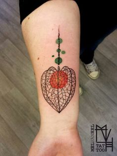 Graphic abstract minimalistic physalis tattoo. Done by Mel van Hel, Lingen (Germany)