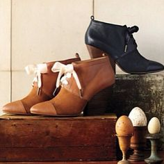 Anthropologie Looking for booties that have a ladylike demeanor? The Gwen Booties are perfect in navy or brown.  601.898.1201 @Anthropologie @renaissanceatcolonypark #shoprenaissance #fall2013 #fashion #footwear #booties #boots