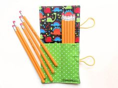 Mini Pencil Roll  Tiny Dino  dinosaur colored by paperfromheaven Kids Travel Ideas // Colored Pencil Roll // Party Favor