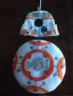 BB-8 infant costume Made a pillow to velcro onto a onesie. Cutout patters by hand and hot glued to match BB-8. Used pipe cleaner for antenna, silver sharpie and paper for his little lights.