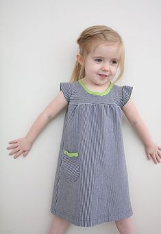 don't know what to do with those old shirts? new dress for your little girl!