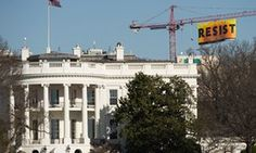 Greenpeace activists hang giant 'Resist' banner near White House Demonstrator condemns Trump's moves on reproductive rights and environment from 300ft in the air as she supports 70ft banner