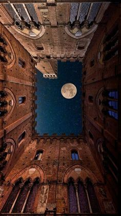Full moon viewed from the Town Hall building in Siena, Italy. Beautiful moon photography by Mauro Maione. For more full moon pics, see our photo galleries. Beautiful Moon, Beautiful World, Beautiful Places, Stars Night, Stars And Moon, Oeuvre D'art, Abandoned Places, Belle Photo, Night Skies