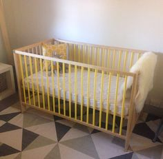 IKEA cot with a lick of yellow paint