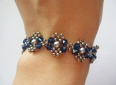This tutorial includes details, easy step by step instructions with colour photos/pictures and all of materials list. The bracelet is made using Swarovski bicone, pearl and seed beads, which are easily available. Time required approximately 2 hr Number of pages 12 Number of Steps 29