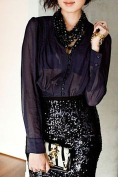 black sequin skirt, black sheer blouse, black statement necklace, clutch w/ heavy hardware