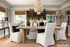 Dining room-love the rustic dining table, slip covered chairs, exotic hutch and glam chandelier.