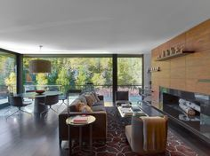 Modern Family Room Decoartion Inside Aspen Art House Applied Contemporary Fireplace Along With Wall Shelving Also Grey Fabric Sofa