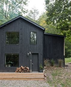 "The overall inspiration for the exterior was to create a ""witch barn"". Basically just paint it black and let the exterior elements pop. It looks great in the summer and in the winter with 2 ft. of snow. The boards were stained black and attached with the rough side out to maintain a very flat and textured look, which relates back to the woods and mountain it sits on."