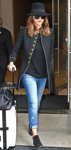 Jessica Alba in a black top, jacket, distressed jeans and booties - click through for more spring outfit ideas from celebrities