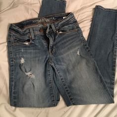 Distressed skinny jeans Super cute skinny jeans! They are in great shape with little wear, the little tears and rips were there with purchase. It hear jeans are mid rise with a bit of stretch for comfort. American Eagle Outfitters Jeans Skinny