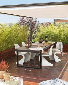 Comedor exterior con sillas Panton
