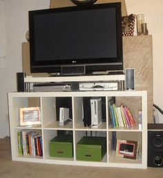 """Great idea - IKEA Expedit shelf + Lack shelf/ledge to elevate TV for electronic equipment storage. Pinned from """"IKEA Hackers"""" blogspot: http://www.ikeahackers.net/2010/10/expedit-entertainment-center-with.html"""