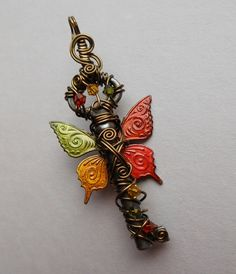 Butterfly Winged Key Pendant -- Autumn Red, Orange, Yellow, Green Patterned Butterfly Winged Wire Wrapped Antique Key with Swarovski Crystal...