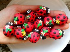 ladybugs. these would be great decorations to put on top of the soil it a potted plant. Polymer Clay Animals, Polymer Clay Flowers, Fimo Clay, Polymer Clay Jewelry, Rock Art, Ladybugs, Ladybug Rocks, Rock Painting, Pebble Painting