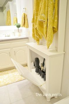 Practical Bathroom Storage Ideas--love the hidden cubby for hair tools, including outlets!