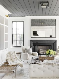 Living room with a minimal color palette and chunky knits and textures
