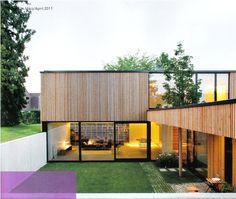 Modernin puutalon rakentamista ja sisustusta skandinaavisella tyylillä.