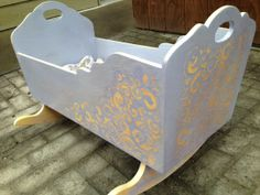 Baby Cradle painted with CeCe Caldwell chalk paint.  Texturized with wood icing.  Sweet!