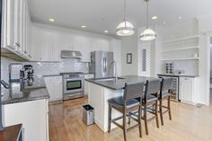 Traditional Kitchen with Crown molding, Wine refrigerator, Undermount Sink, Complex granite counters, High ceiling, U-shaped