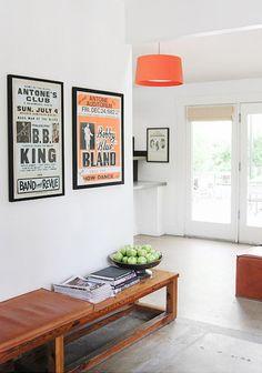 Hotel San Jose, Austin TX showcases its minimal design with framed artwork and bold orange pendant.