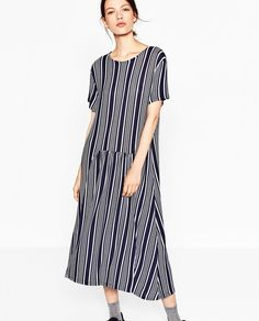 STRIPED DRESS WITH FRILL - COLOR: Grey / Blue Below-the-knee dress. Round neck. Short sleeves. Gathered at the front. OUTER SHELL - 98% viscose, 2% elastane