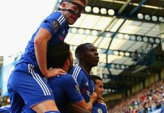 Zouma, the France international, is mobbed by his Chelsea team-mates after opening the scoring against Arsenal Chelsea Team, Chelsea Football, Real Soccer, Soccer Fans, Eden Hazard Goals, Stamford Bridge, Football Pictures, Go Blue, Psychic Abilities