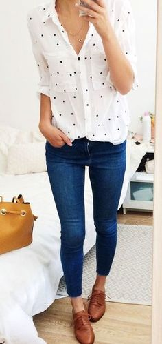 #fall #outfits woman's white and black button-up shirt with blue skinny jeans and piar of brown leather shoes