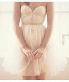 a feminine short wedding dress. http://www.olamweddings.com/inspiration.php#   found on prince of paris.