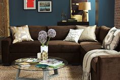 I love the blue walls and brown couch, so warm and cozy