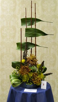 I love the Aspidistria leaves on the bamboo Contemporary Flower Arrangements, Creative Flower Arrangements, Church Flower Arrangements, Ikebana Arrangements, Floral Arrangements, Leaf Design, Floral Design, Arte Floral, Leaf Art