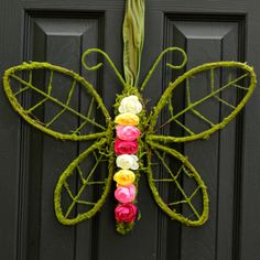 A butterfly made of a moss grapevine base, accented with artificial ranunculus in pink, white and yellow. All topped with a moss loop for hanging. ✿ ✿ ✿ ✿ ✿ ✿ ✿ ✿ ✿ ✿ ✿ ✿ ✿ ✿ ✿ ✿ ✿ ✿ ✿ ✿ ✿ ✿ ✿ ✿ ✿ ✿ ✿