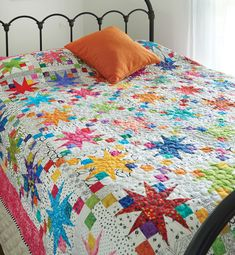 Bright batiks and light prints will make this quilt pattern a lovely sight to wake up to every morning! Bright batiks and light prints will make this quilt pattern a lovely sight to wake up to every morning! Star Quilt Blocks, Star Quilt Patterns, Star Quilts, Tropical Quilts, Colorful Quilts, Quilt Baby, Quilt Bedding, Bedspread, Bedding Sets