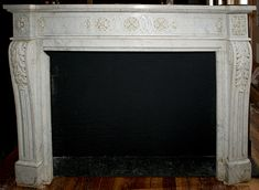 """With Mendota FV 41  (1"""" short or reqd height-can adapt)  Item ID: 101553  Description:Louis XVI style marble fireplace having carved acanthus décor on jambs and frieze. Provenance: Plaza Hotel. Opening: 44W x 34H. Material:Marble Dimension: 64.5(W) 46.25(H) 15.5(D) Location:NYC-4 Quantity:1 Status:avail Price:Call for Price Price Type:single"""