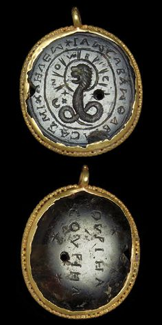 An ancient Roman gold and heliotripe magical pendant. (Christie's)