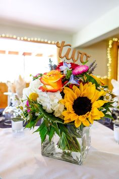Floral centerpiece, sunflower, sunset rose, gold table number //  Visual Poetry