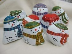 cute snowmen painted rocks