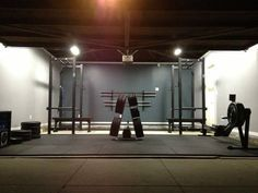 The perfect his and her garage gym; beautiful!