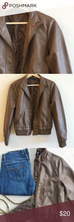 Brown Faux Leather Bomber Jacket Like new faux leather brown Forever 21 bomber jacket. Size: Large. I bought this from another Posher, but it's too big for me (sometimes I find F21 to run small, but this jacket is true to size). Gorgeous brown color in like new condition. Very light pilling (hardly noticeable) on the arm cuffs due to light wear. Jacket material in PERFECT condition. Great piece for fall!! 🍁🍂 PRICE is now FIRM! ✔️ Bundle to save!!! 😘 Forever 21 Jackets & Coats