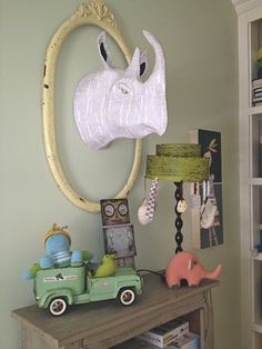 toddler boy room. How cute would it be to have different animal heads in newsprint all around?!!