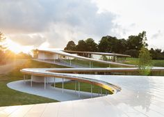 Japanese studio SANAA has completed a sinuous building of glass, concrete, steel and wood that winds across the landscape of a nature reserve in New Canaan, Connecticut. Named The River in reference to its ribbon-like roof, the building frames both public facilities and meandering walkways for Grace Farms, a new 80-acre (32 hectare) reserve of meadows, woods, wetlands and ponds.