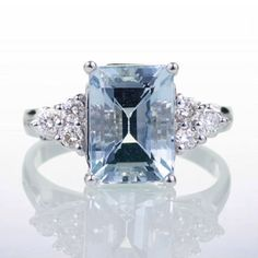 I love the fact that its blue! Emerald Cut Aquamarine Engagement Wedding Ring by samnsue on Etsy, $988.00