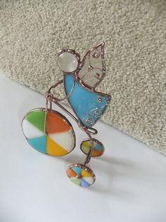 Stained glass angel on a bicycle.Tiffany style.Stained by mamichka