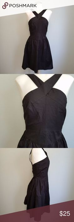 """Moda International Black Criss Cross Halter LBD Criss-cross front halter dress by Moda International for Victoria's Secret. Double strap lower back. Zipper back with hook and eye. Fit and flare style fit. Little Black Dress status! Excellent condition. Like new, no signs of wear. Size 12. 17"""" Underarm/Bust, 15 3/4"""" waist, 37"""" long shoulder to hem, 20"""" bottom of waist band to hem. 96% Cotton, 4% Elastane. Moda International Dresses"""