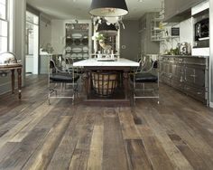 love a rustic floor with a contemporary kitchen! See more floors at http://renovationbootcamp.com/grounded-2nd-part-in-the-series-on-flooring-for-the-home/